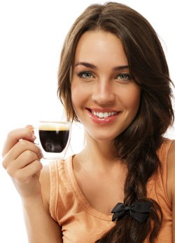 Woman holding a coffee cup while smiling